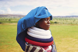 Batwane Woman in Traditional Dress