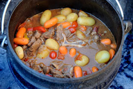 Afrikaans Cuisine: Potjiekos (a stew cooked in a 3-legged African pot)