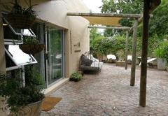 Aloe garden apartment entrance, patio and braai area