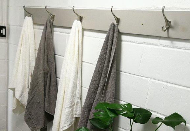 grey and white interiors with towels and toiletries suppplied