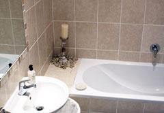 Main bathroom with bath and shower