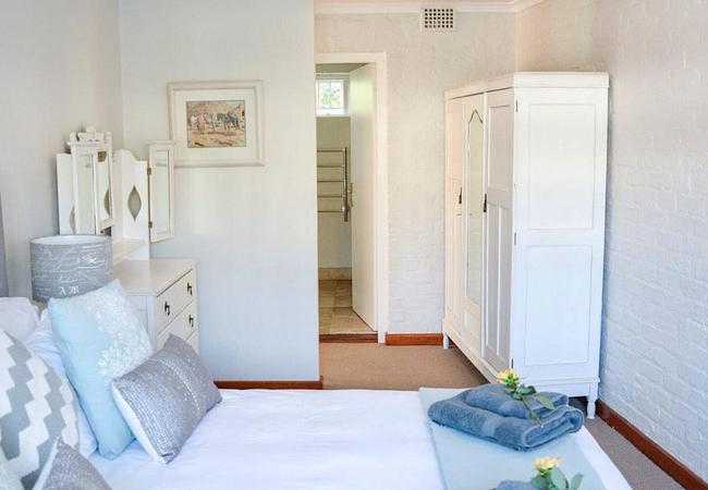 Rose Suite bedroom through to bathroom