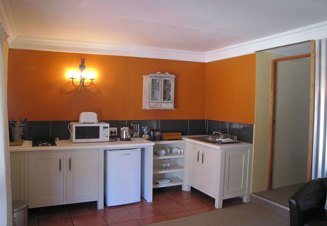 Ouhout apartment kitchenette