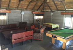 Lounging area with pool table, TV and fooseball table