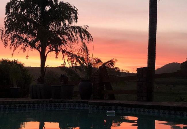 Sunset over pool