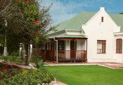Rooms 1 - 4 terrace overlooking well manicured garden