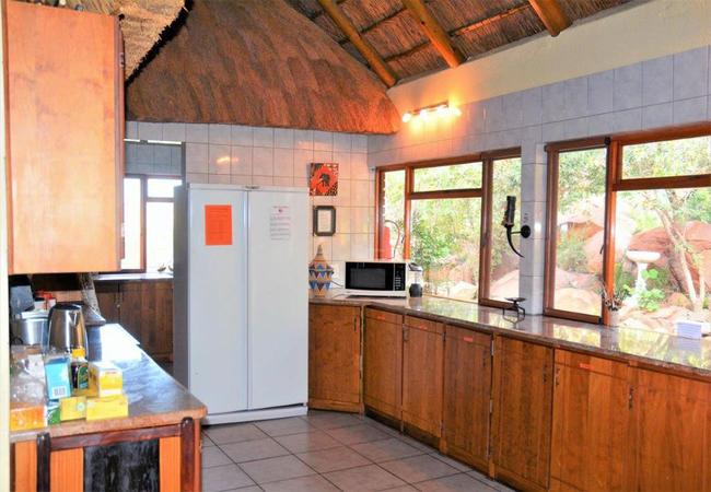 Spacious kitchen with bush view