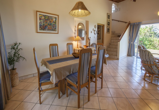 Dining area showing staircase leading to top lounge and balcony
