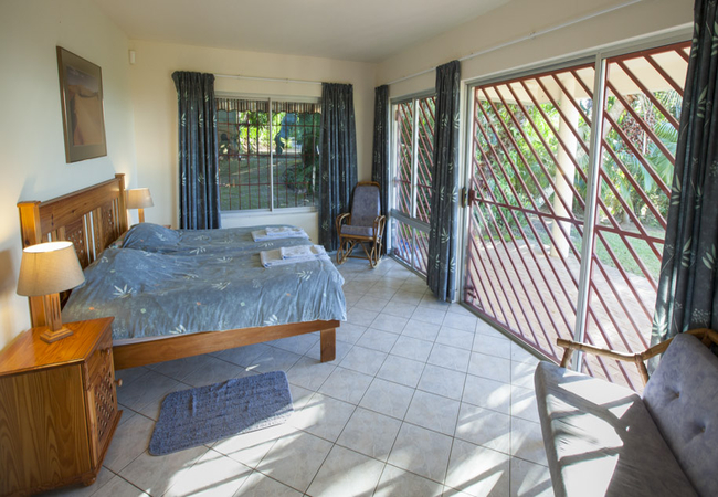 Main bedroom with King size bed and view into the garden
