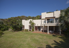 Ocean View Beach House and braai area in a tropical garden