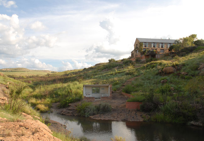 View of the house from the little dam.