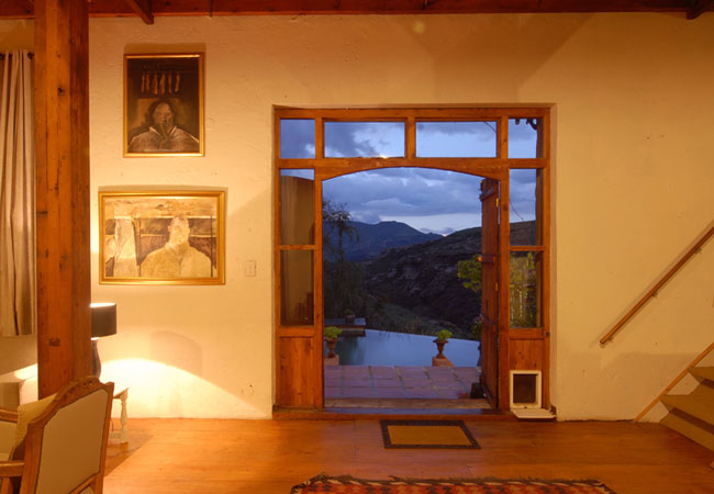 Pool and mountain view through front doors.