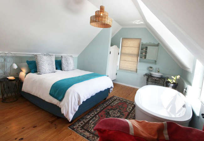 Upstairs Queen bedroom with ocean and mountain views
