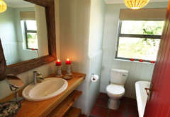 Downstairs Bathroom with Bath Toilet and Handbasin