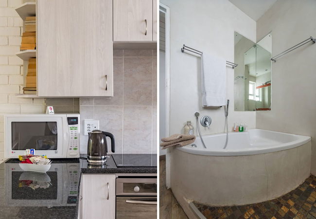 Bathroom with bath and hand shower, as well as separate shower