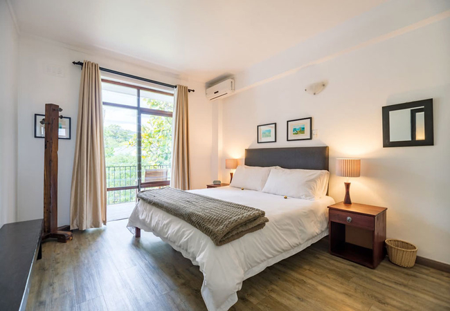 Large air-conditioned bedroom with extra-length king size bed