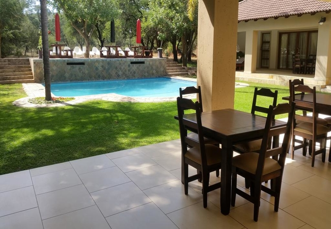 Swimming pool viewed from the patio of the dining area