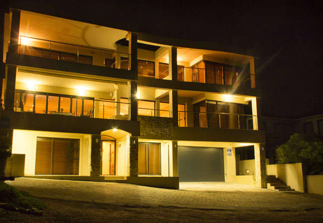 Exterior of the house at night.