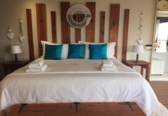 Flamingo\'s Nest bedroom with beautiful ocean view and a private deck