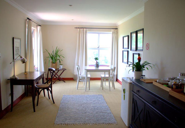 Dining area and workstation. Sideboard with kettle, toaster and microwave