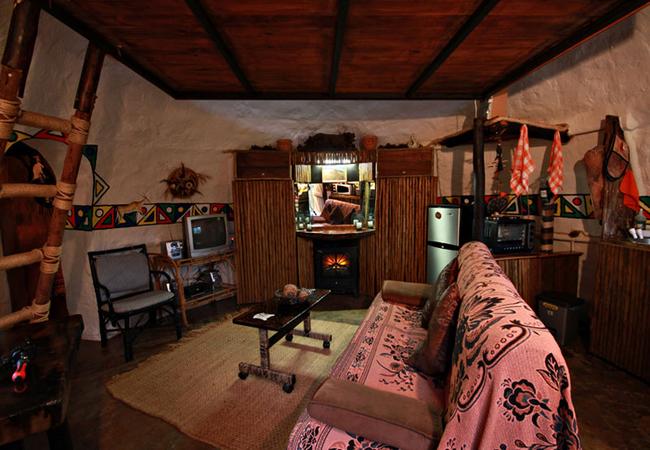 Lounge/kitchen area of The Zulu Hut